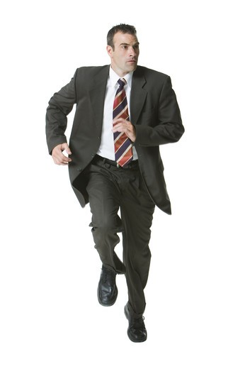Stock Photo: 1660R-49884 Man running in three piece suit