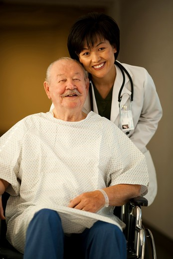 Stock Photo: 1660R-50080 Female doctor with mature man in wheelchair
