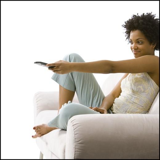 Stock Photo: 1660R-50313 Woman with a remote control