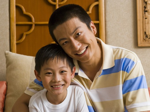 Stock Photo: 1660R-50424 Father and son smiling
