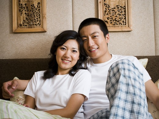 Stock Photo: 1660R-50425 Couple in bed hugging and smiling