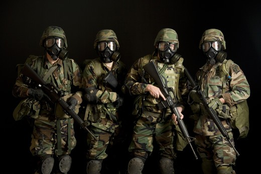 Two soldiers posing with gas masks : Stock Photo