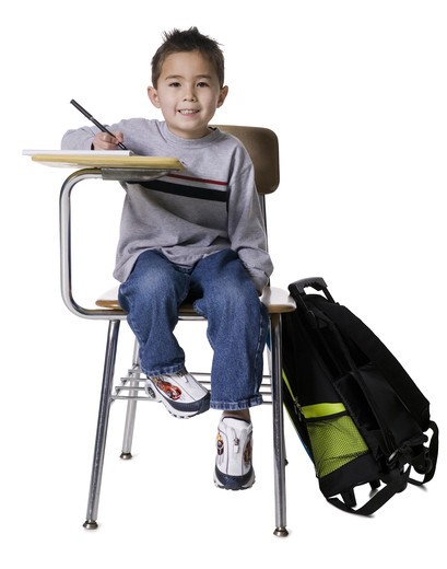 Stock Photo: 1660R-51047 Schoolboy at desk