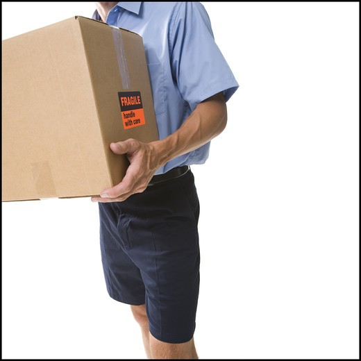 Delivery man with damaged package : Stock Photo