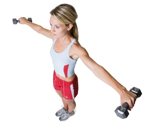 Woman holding weights : Stock Photo