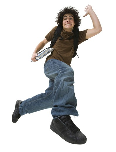 Portrait of a teenage boy making a face and jumping in mid-air : Stock Photo