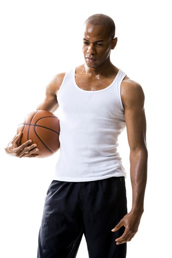 Man holding a basketball : Stock Photo