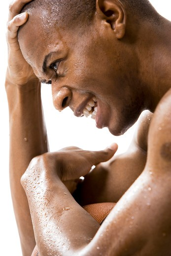 Stock Photo: 1660R-52386 Man sweating with basketball