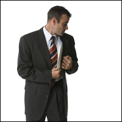 Stock Photo: 1660R-52500 Businessman putting files into his jacket