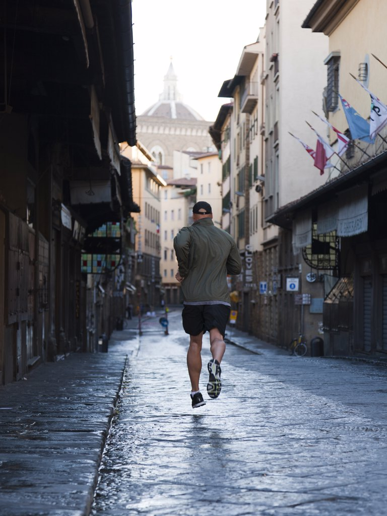 Stock Photo: 1660R-52746 Italy, Florence, Man jogging in city