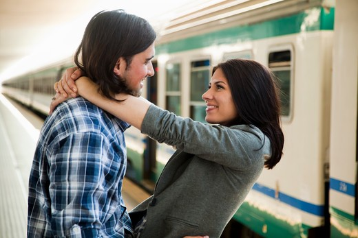 Stock Photo: 1660R-53154 Italy, Venice, Young couple embracing on railway station