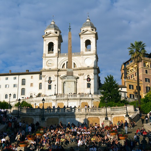 Stock Photo: 1660R-53182 Italy, Rome, Tourists on Spanish Steps at sunset, church of the Santissima Trinita dei Monti in background