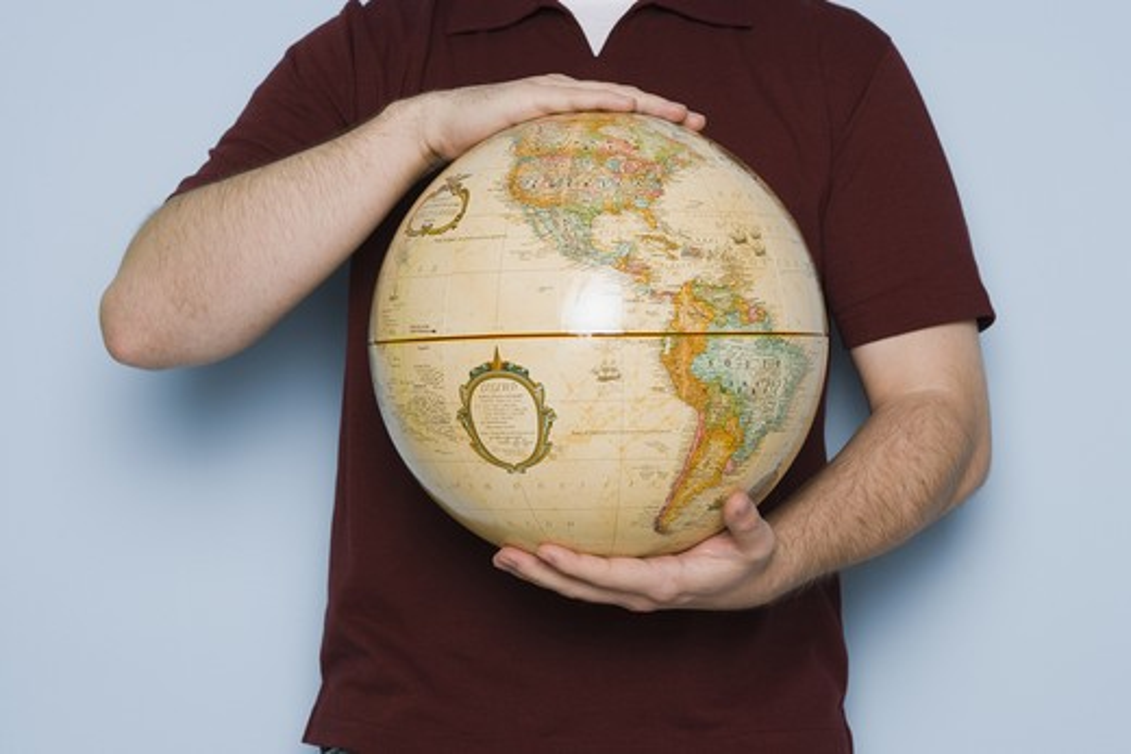 Man holding globe : Stock Photo