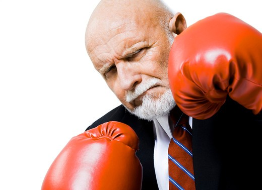 Closeup of businessman with boxing gloves : Stock Photo