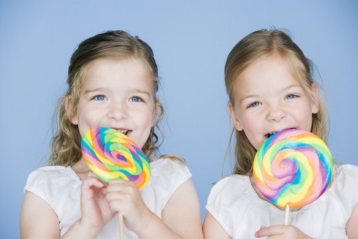 Stock Photo: 1660R-54219 Girls with lollipops