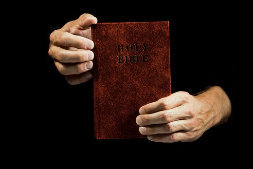 Reading the bible : Stock Photo