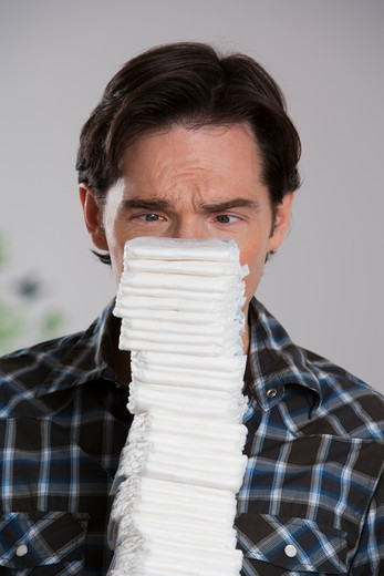 Stock Photo: 1660R-54557 Man holding diapers