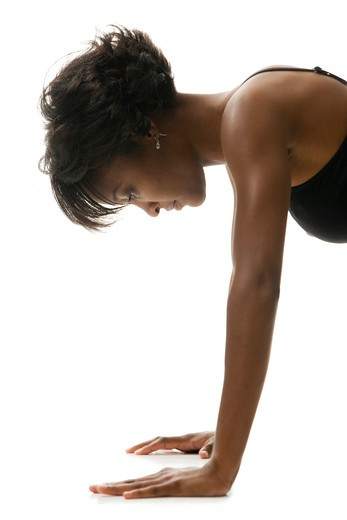Stock Photo: 1660R-54730 Woman doing pushups