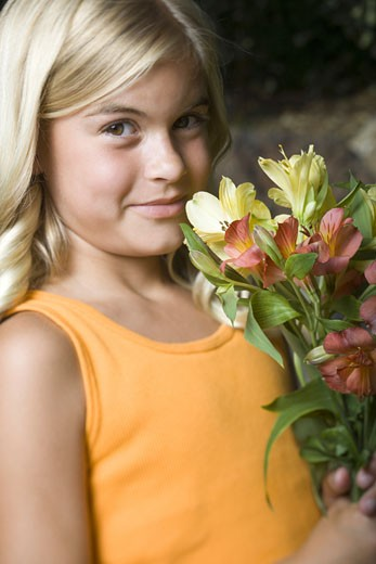 Stock Photo: 1660R-5490 Close-up of a girl holding a bunch of flowers