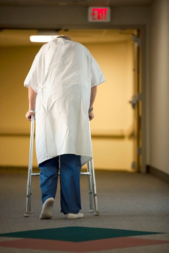 Stock Photo: 1660R-55017 Mature man in hospital gown with walker