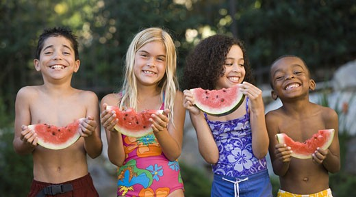 Stock Photo: 1660R-5507 Close-up of children holding watermelons and smiling