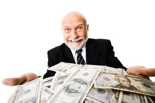 Excited mature man with large sum of money : Stock Photo