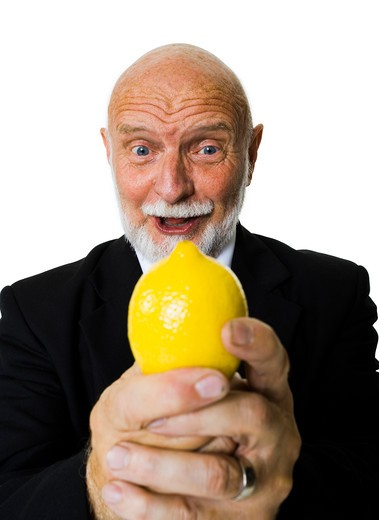 Stock Photo: 1660R-55283 Mature businessman with lemon