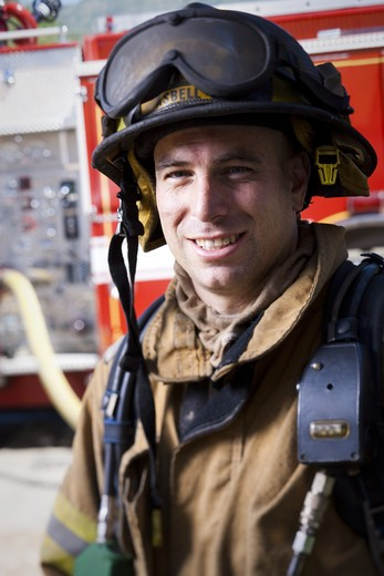 Stock Photo: 1660R-55367 Fire fighter in uniform smiling