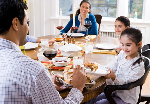 Stock Photo: 1660R-55921 Family sitting at dinner table
