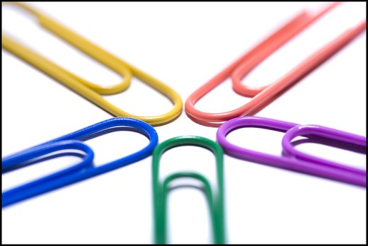 Multi coloured paperclips attached : Stock Photo