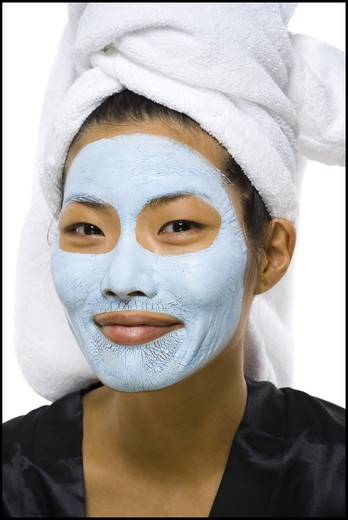 Stock Photo: 1660R-56252 Closeup of woman smiling with facial mask and hair towel