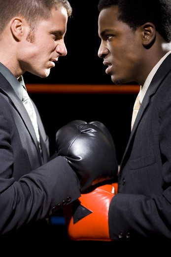 Businessmen boxing : Stock Photo