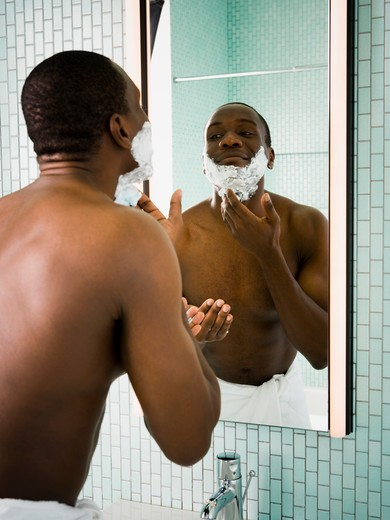 Stock Photo: 1660R-57099 Male grooming himself