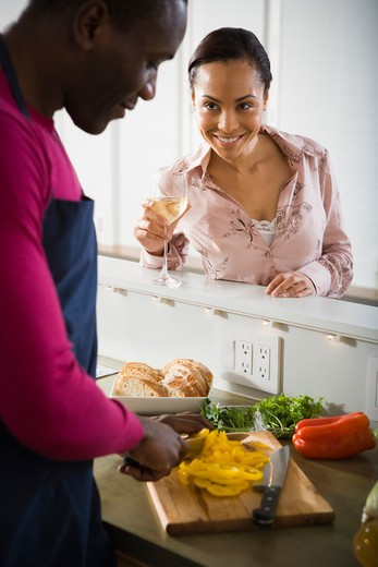 A couple preparing food : Stock Photo