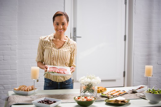 A woman preparing a party : Stock Photo