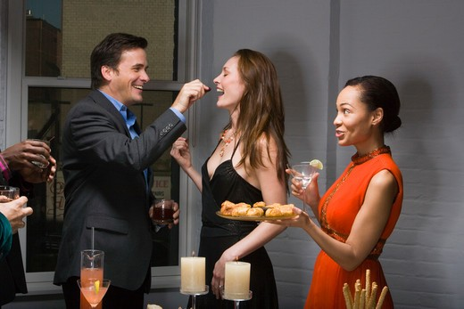 Stock Photo: 1660R-57213 Partygoers eating