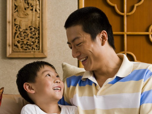 Stock Photo: 1660R-57704 Father and son smiling