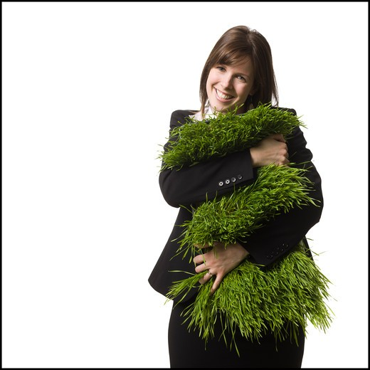 Stock Photo: 1660R-58425 businessperson holding a patch of grass