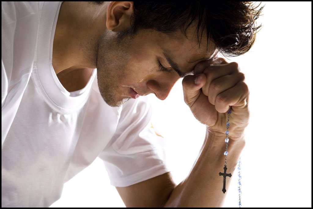Man praying : Stock Photo