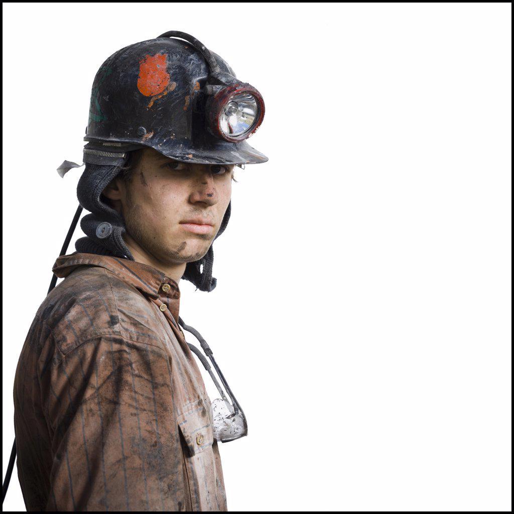 Mine worker with flashlight helmet : Stock Photo