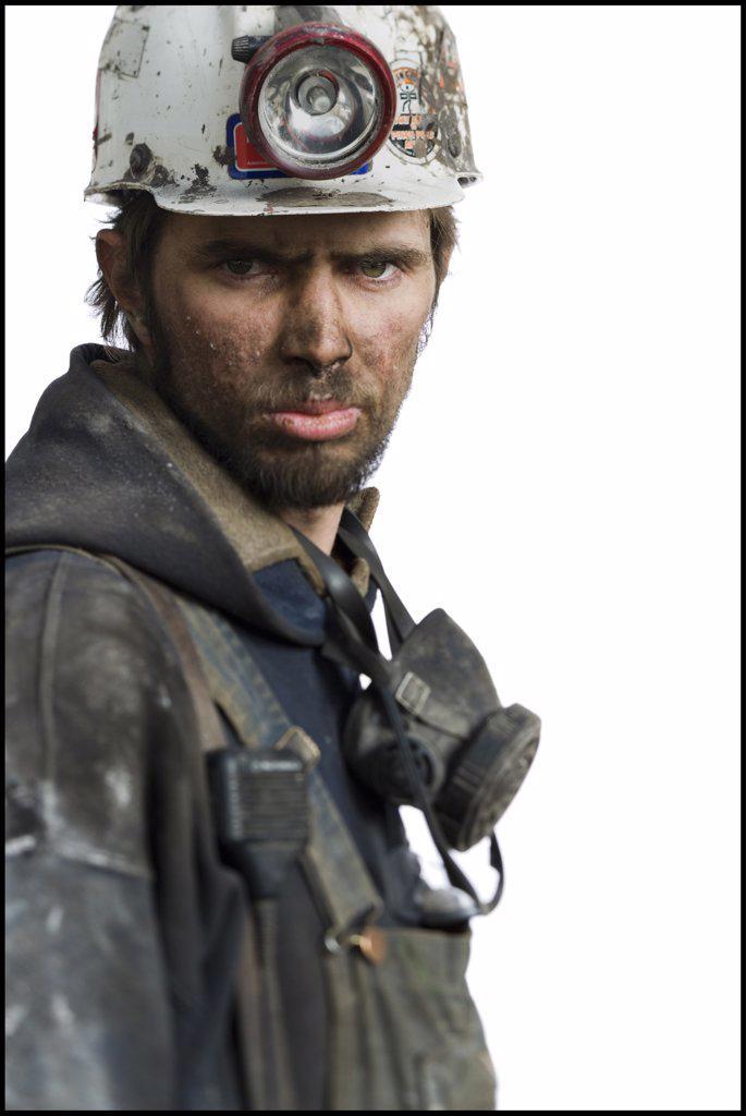 Stock Photo: 1660R-59061 Mine worker with flashlight helmet