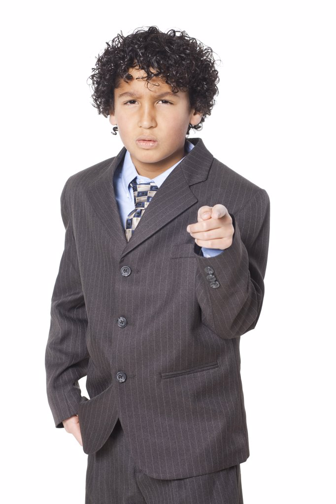 Stock Photo: 1660R-59224 Studio portrait of boy (8-9) wearing suit, pointing
