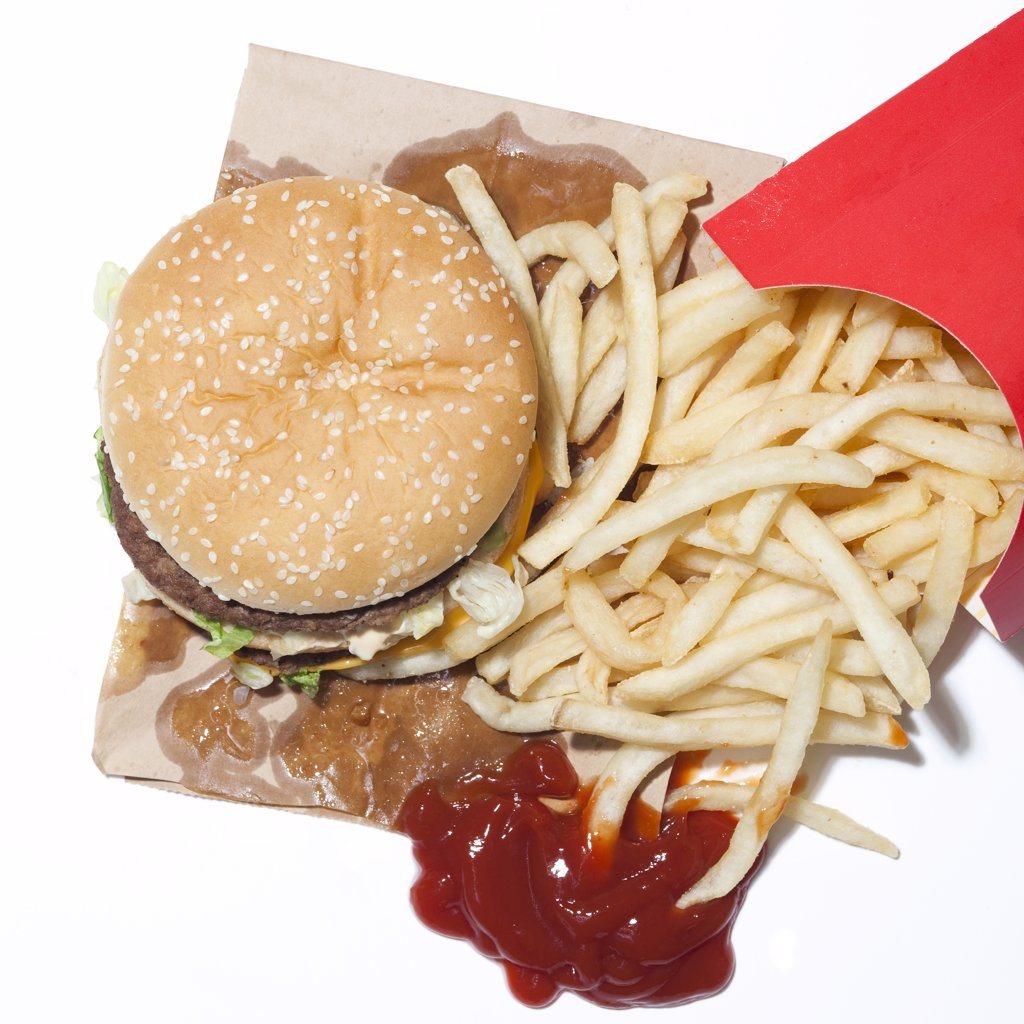 French fries and hamburger, studio shot : Stock Photo