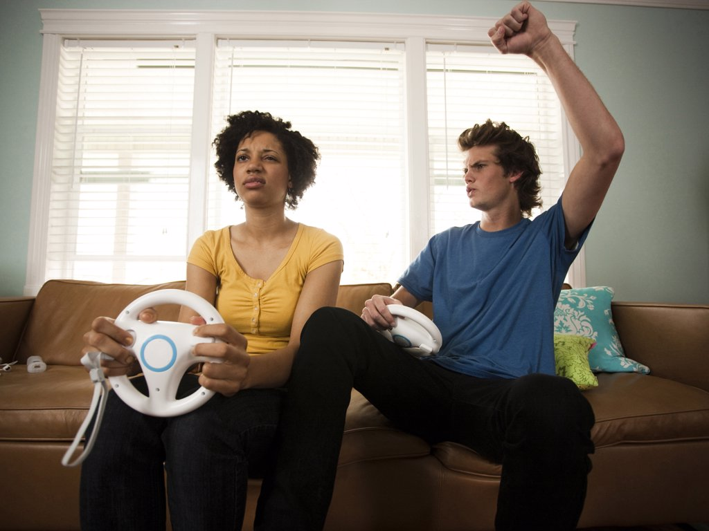 Stock Photo: 1660R-59376 USA, Utah, Provo, young couple playing video games in living room