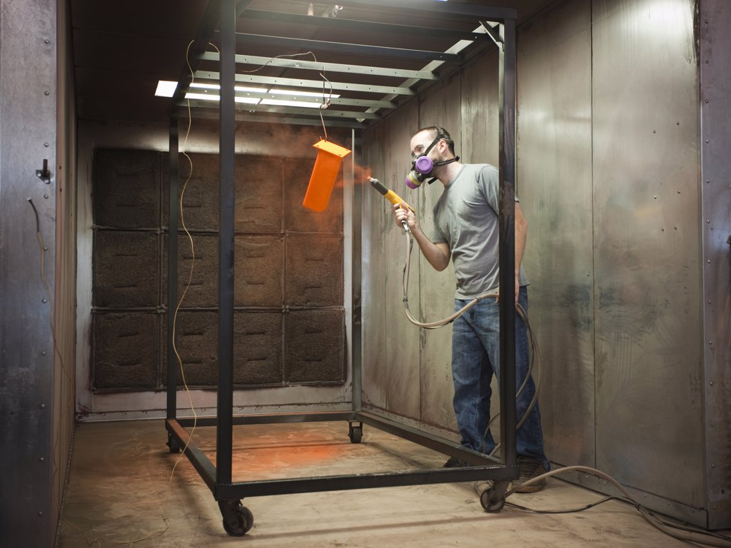 Stock Photo: 1660R-59450 USA, Utah, Orem, man using paint spray gun