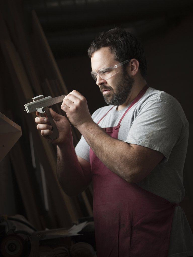Stock Photo: 1660R-60097 USA, Utah, Orem, mid adult carpenter working