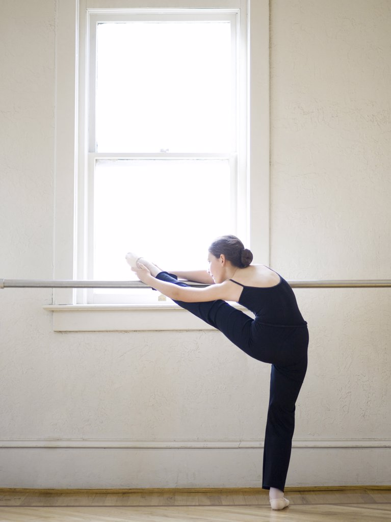 Stock Photo: 1660R-60282 Springville, Utah, USA, Ballet dancer (12-13) stretching