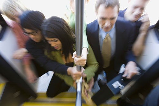 Stock Photo: 1660R-6037 High angle view of passengers boarding a commuter train