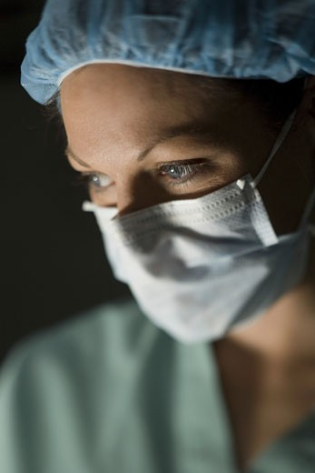 Stock Photo: 1660R-6123 Close-up of a female surgeon wearing a surgical mask