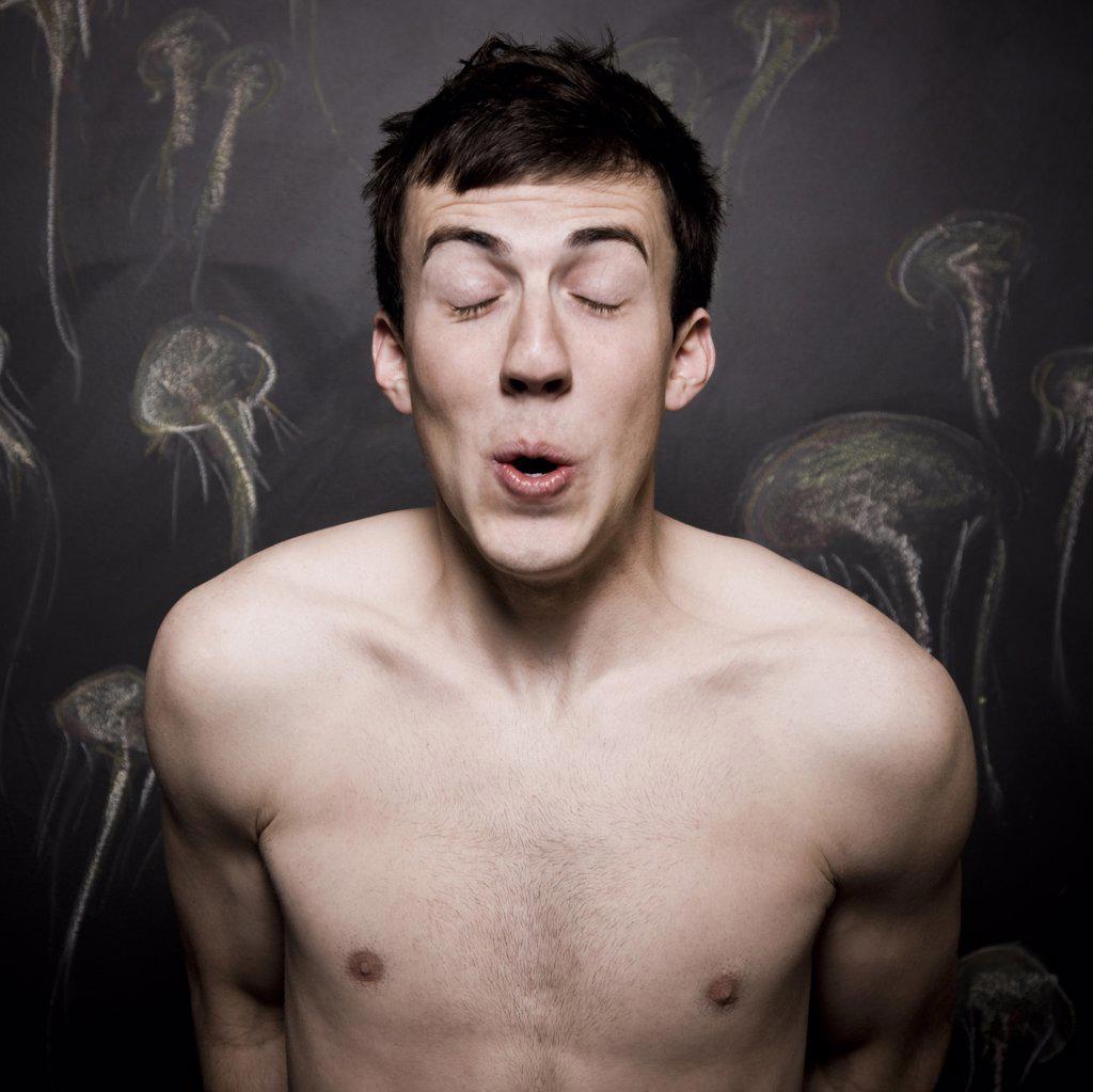 Stock Photo: 1660R-61301 man pretending to be underwater